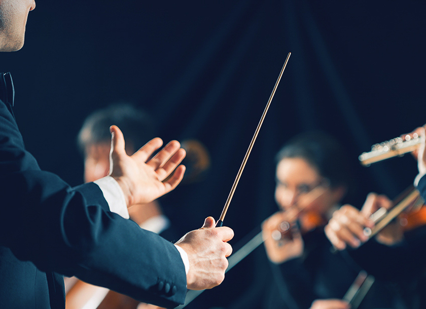 Maestro leading an orchestra