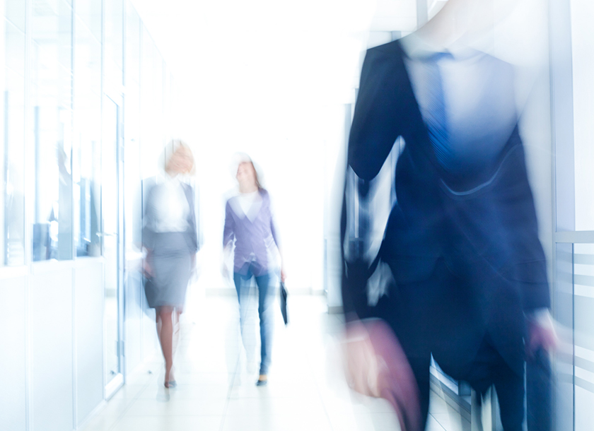 Business men and women walking at the office
